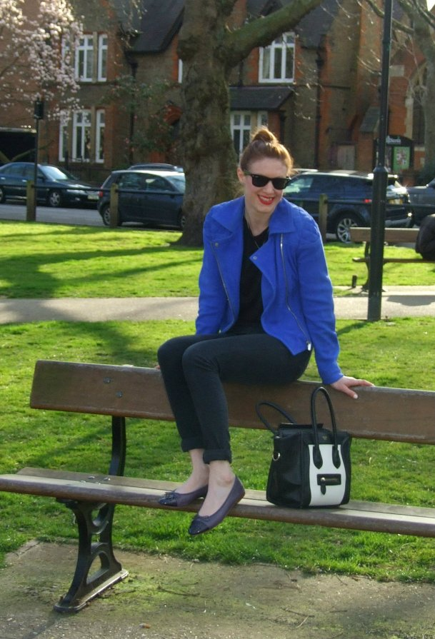 sat on bench smiling